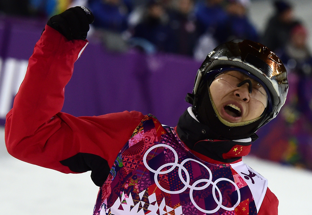 . China\'s Cheng Shuang watches her score at the Women\'s Freestyle Skiing Aerials finals at the Rosa Khutor Extreme Park during the Sochi Winter Olympics on February 14, 2014.  (JAVIER SORIANO/AFP/Getty Images)