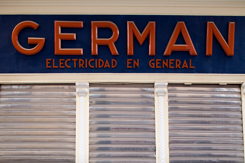 Old sign from a shop of general electrical goods, Seville, Spain