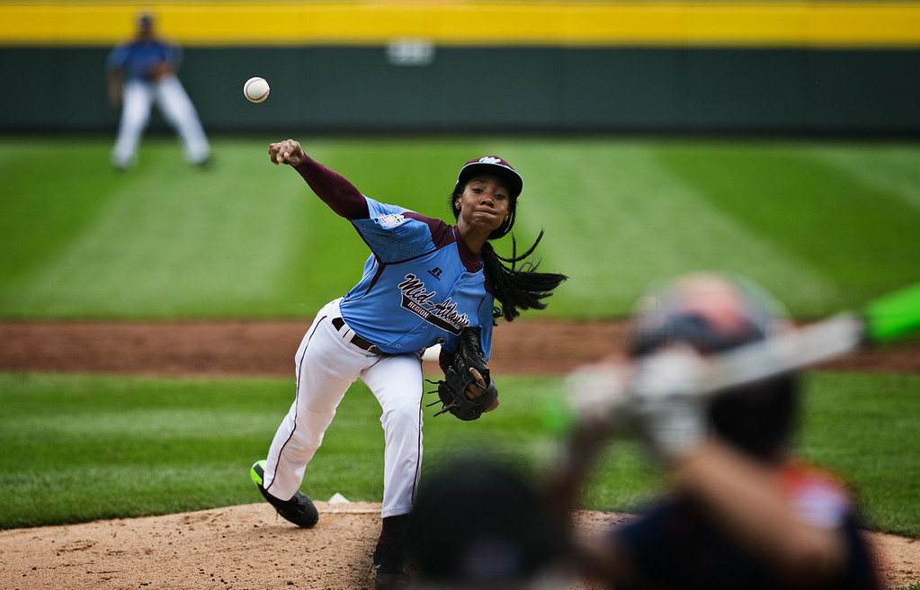 . Philadelphia\'s Mo\'ne Davis delivers a pitch against Nashville during her team\'s 4-0 win in a U.S. pool play baseball game at the Little League World Series, Friday, Aug. 15, 2014, in South Williamsport, Pa. (AP Photo/PennLive.com, Sean Simmers)
