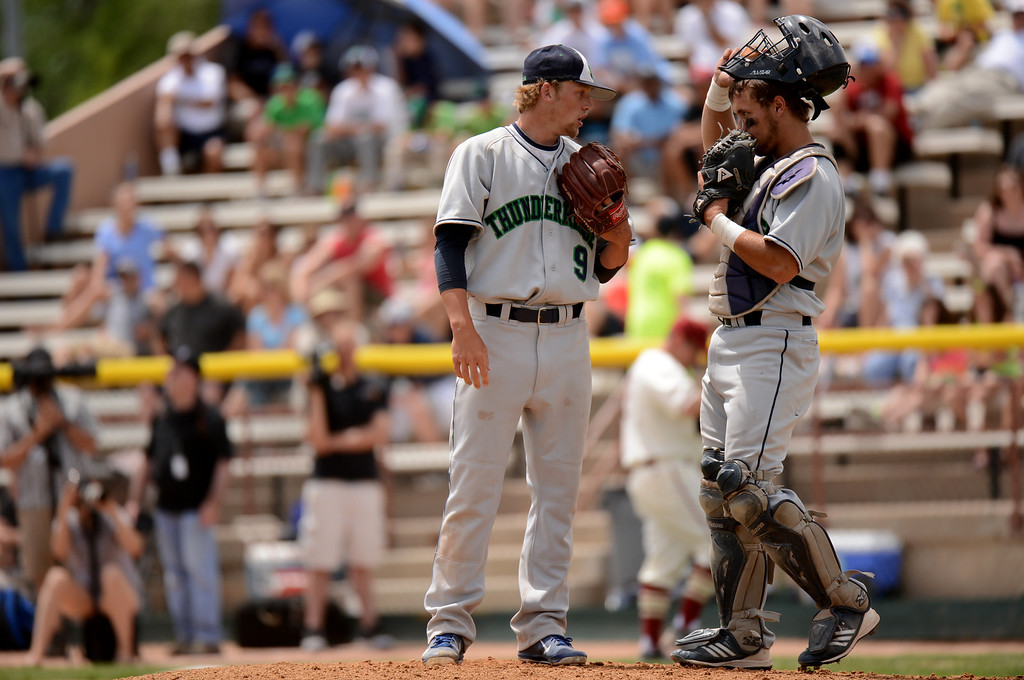 . DENVER, CO. - MAY 25: Andrew Jones (9) and Jake Hand (8) of ThunderRidge HIgh School huddle during the final round of 5A baseball state championship game against Rocky Mountain High School at All City Field. Denver, Colorado. May 25, 2013. ThunderRidge won 2-1. (Photo By Hyoung Chang/The Denver Post)