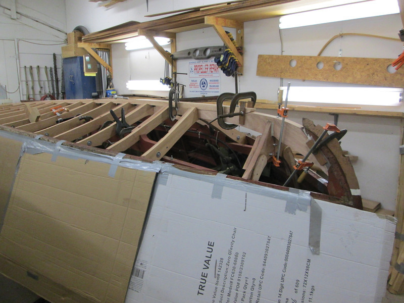 Front view of new keel being fit and new breast hook installed.