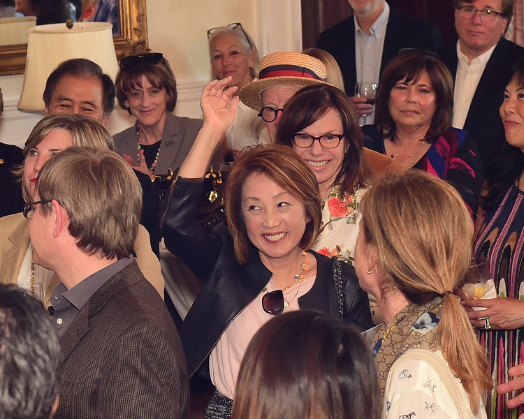 Sachiko Kuno raising hand, Cocktails at Selma Mansion, June 7, 2018, Nancy Milburn Kleck