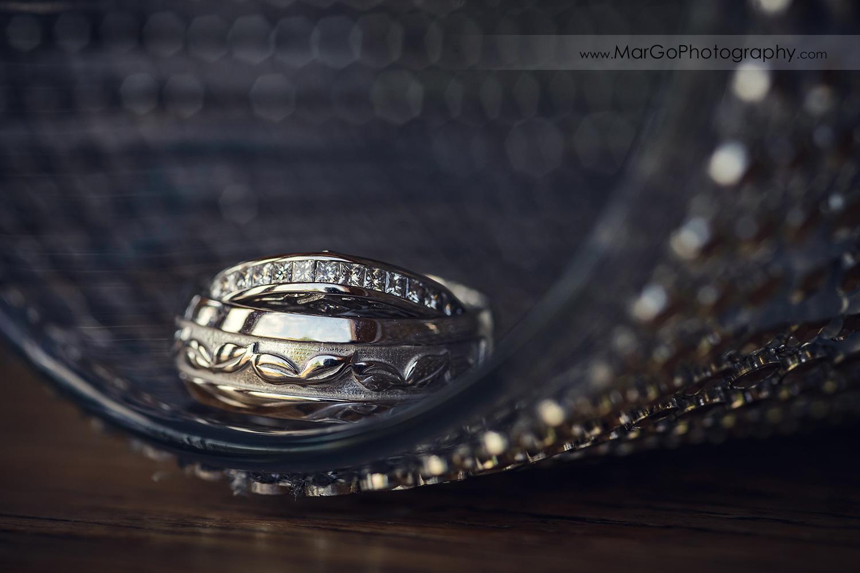 wedding rings in shining arch