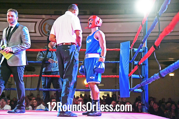 Bout #7:  Isaiah Pellot (Blue Gloves), Empire BC  vs  Dantre Whitfield (Red Gloves), Independent,  132Lbs., Sub-Novice