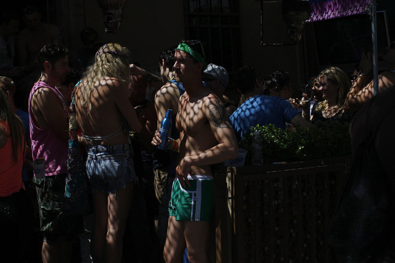 . An awning casts shadows over people attending the 43rd L.A. Pride Parade on June 9, 2013 in West Hollywood, California. More than 400,000 people are expected to attend the parade in support of lesbian, gay, bisexual and transgender communities.  (Photo by David McNew/Getty Images)