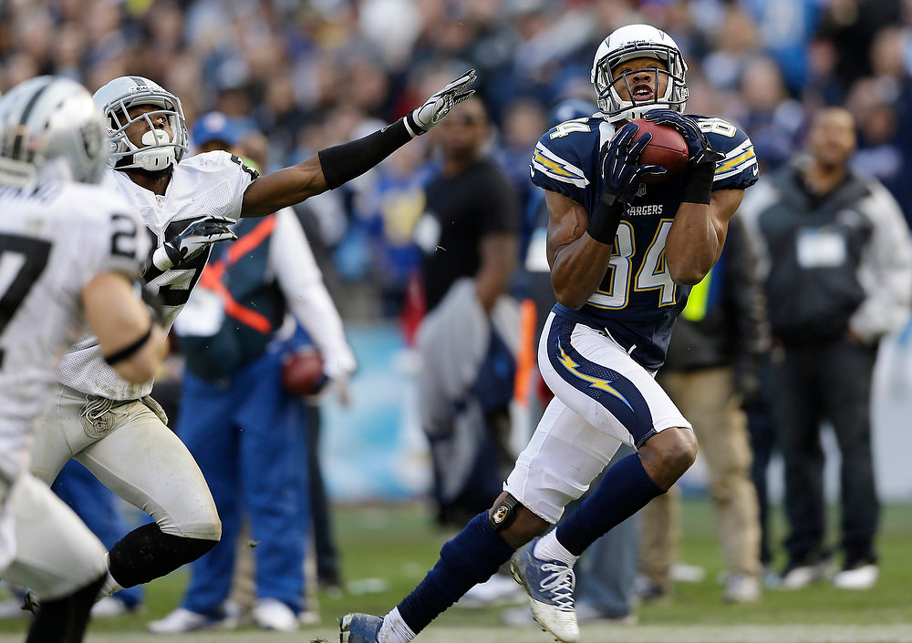 Description of . San Diego Chargers wide receiver Danario Alexander, right, grabs a pass on his way to a touchdown as Oakland Raiders cornerback Brandian Ross, left, can't reach him during the second half of an NFL football game Sunday, Dec. 30, 2012, in San Diego. (AP Photo/Lenny Ignelzi)