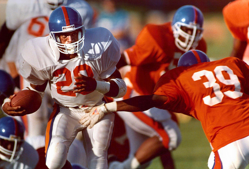 . July 17, 1991: Running back Gaston Green, left, slipped past rookie defensive back Fred Foggie during a scrimmage at training camp. (The Denver Post)