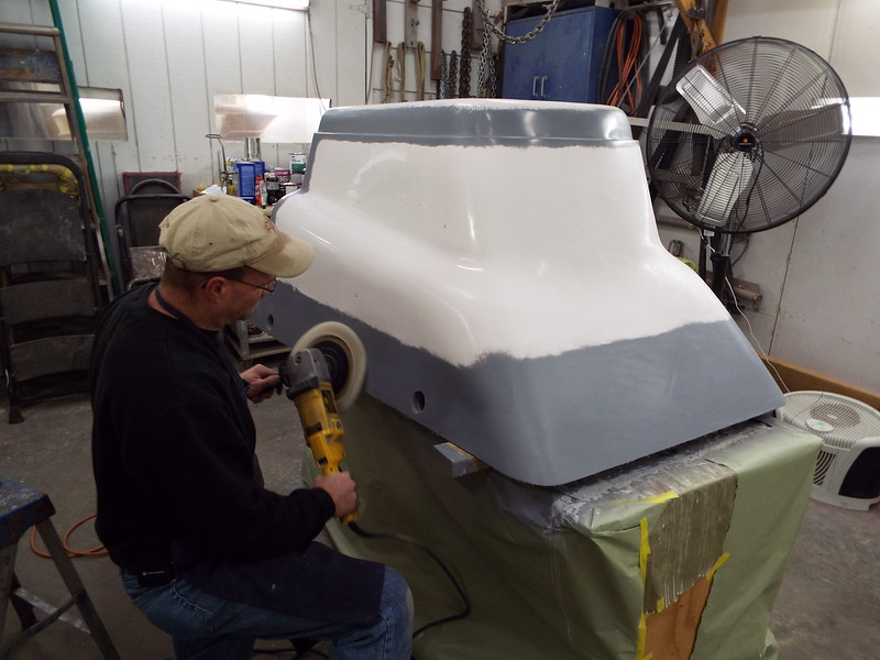 Buffing out the engine box so we can lay up the new part.
