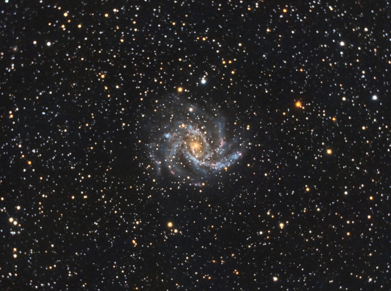 NGC6946, Firecracker Galaxy. 7/1/2011. CPC0800 F/6.3 focal reducer. Mitty Wedge. SXVR-M25C. IDAS LPS Filter. Hutech OAG. Lodestar. 30 x 10 minutes. Total 300 minutes. Pre-Processed (BPM, Bias, Flats Calibration and Debayer) with Nebulosity. Stacked and Post-processed with PixInsight. PHD settings: RA Aggressiveness: 90, RA Hysteresis: 10, RA Max Duration: 600, Dec Max Duration: 600, Min Motion: 0.60, Calibration Steps: 500msec, Auto/Resist Switching, Dithering: Extreme and Settle < 0.5, 0.2 sec guiding exposure.