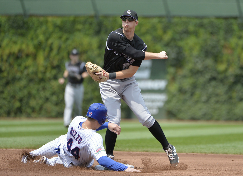 . Second baseman D. J. LeMahieu #9 of the Colorado Rockies forces out Anthony Rizzo #44 of the Chicago Cubs at second base and throws to first to complete a double play on a ground ball hit by Starlin Castro during the first inning at Wrigley Field on July 31, 2014 in Chicago, Illinois.  (Photo by Brian Kersey/Getty Images)