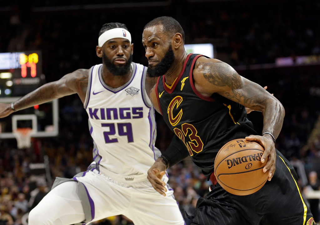 . Cleveland Cavaliers\' LeBron James (23) drives against Sacramento Kings\' JaKarr Sampson (29) in the first half of an NBA basketball game, Wednesday, Dec. 6, 2017, in Cleveland. (AP Photo/Tony Dejak)