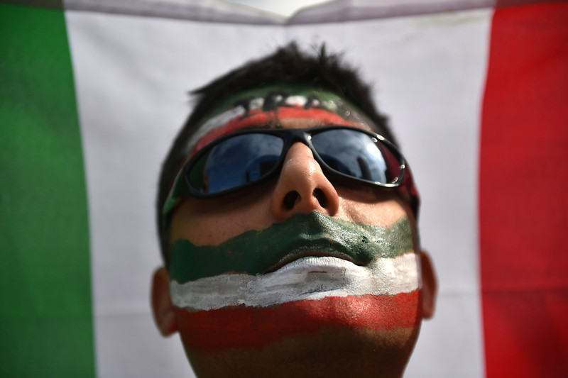 . An Iranian fan reacts during a Fanfesta\'s live projection of a Group F football match between Argentina and Iran at Copacabana beach in Rio de Janeiro on June 21,2014 during the 2014 FIFA World Cup.  (YASUYOSHI CHIBA/AFP/Getty Images)