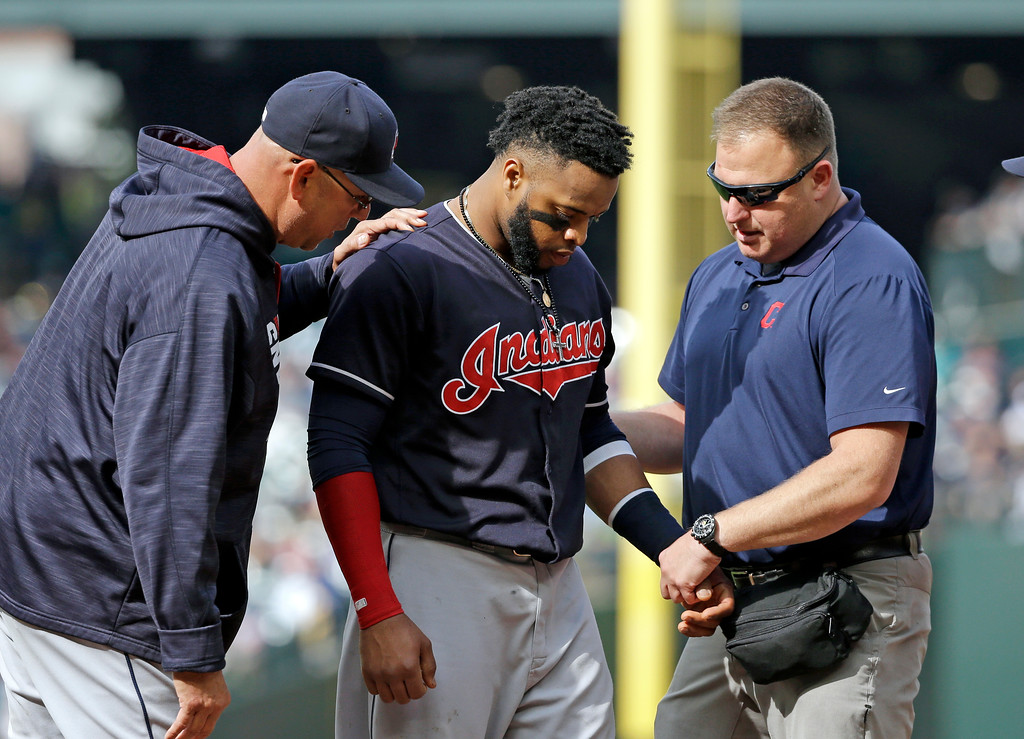 . Cleveland Indians first baseman Carlos Santana is checked during a baseball game against the Seattle Mariners Saturday, Sept. 23, 2017, in Seattle. Santana remained in the game. (AP Photo/Elaine Thompson)