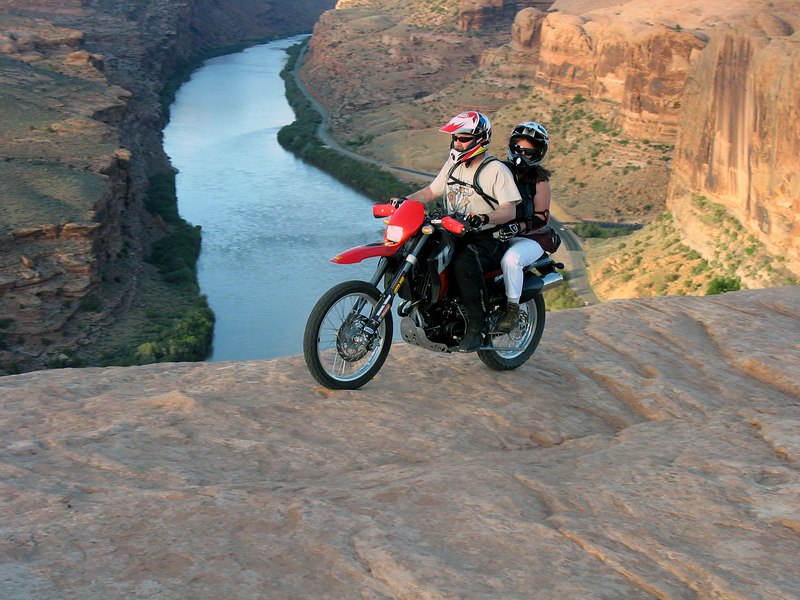"""The VERY first day, almost the first thing we did on arriving was head out to take a loop around the infamous """"slick rock trail""""...  Very good time.  Sort'a hard to tell from the photo, but just to our left - WAY down, and I mean <b>WAY</b> down..  ;-)</font>"""