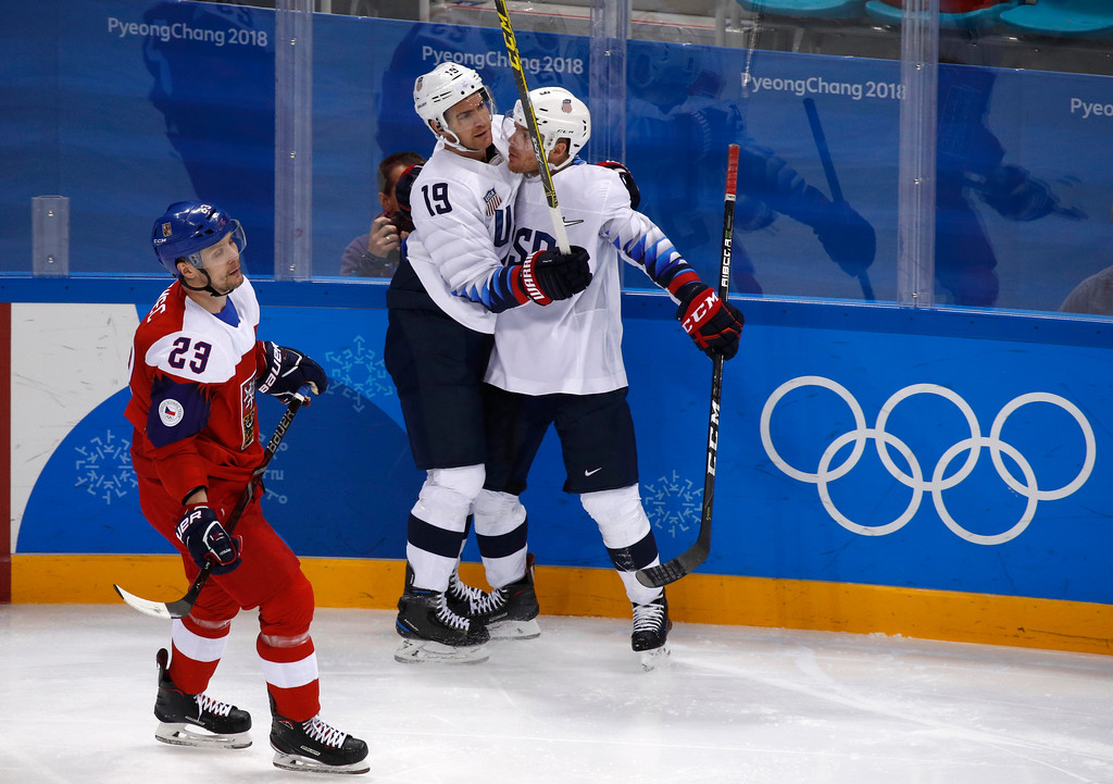 . Jim Slater (19), of the United States, celebrates with Brian O\'Neill (9) after scoring a goal against the Czech Republic during the second period of the quarterfinal round of the men\'s hockey game at the 2018 Winter Olympics in Gangneung, South Korea, Wednesday, Feb. 21, 2018. (AP Photo/Jae C. Hong)
