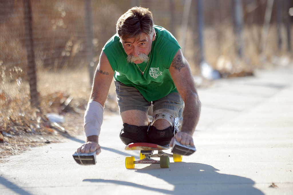 . Jesse Swalley of Sylmar, became paralyzed in one of his legs after he was stabbed in 1991.  He now rides long distances on his skateboard while kneeling.(Andy Holzman/Los Angeles Daily News)