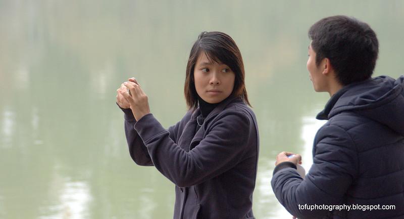 Couple by the Hoàn Kiếm Lake in Hanoi, Vietnam in January 2012