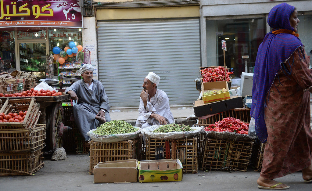 . Egyptian street vendors wait for customers at a crowded street in Cairo on August 26, 2013. In recent days, violence in Cairo appears to have abated, prompting authorities to announce that they would shorten a night-time curfew by two hours. The curfew was imposed in 14 provinces on August 14, as violence ripped through the country when security forces began the forcible dispersal of two camps of supporters of ousted Egyptian president Mohamed Morsi and members of the Muslim Brotherhood.  AFP PHOTO/MARWAN NAAMANIMARWAN NAAMANI/AFP/Getty Images