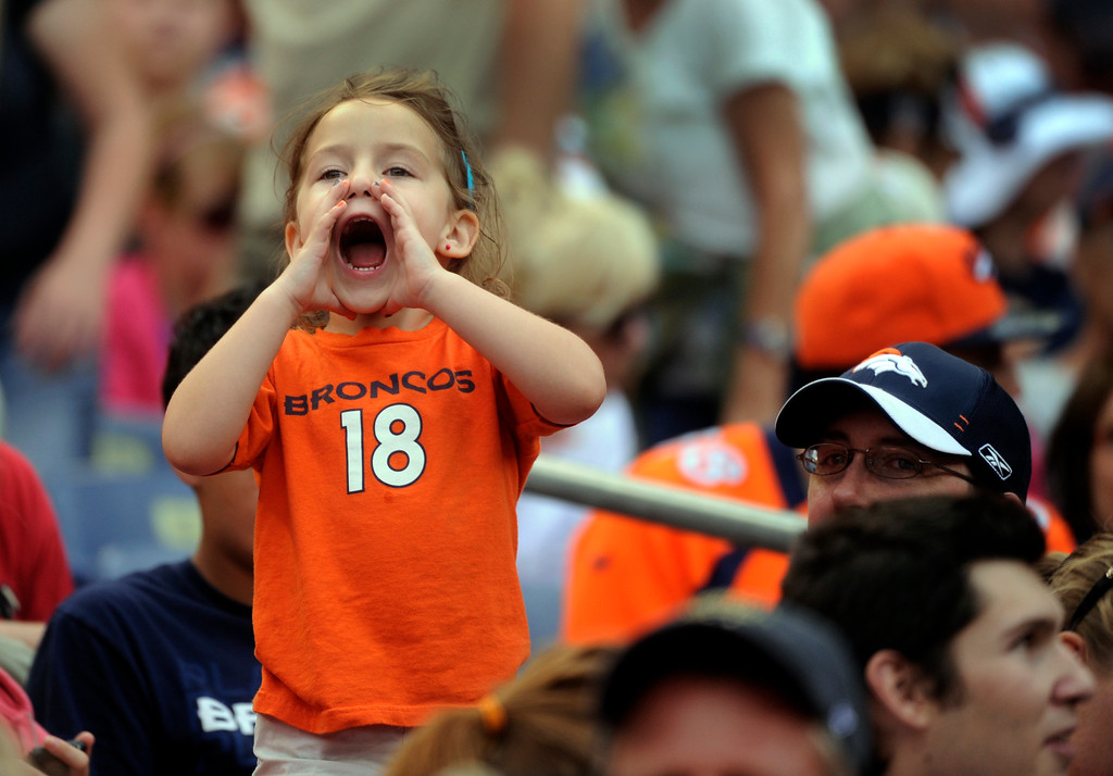 """. DENVER, CO. - AUGUST 03: \""""Peyton Manning, I love you,\"""" screamed Alyssa Knutson, age 5, from the stands Saturday. She attended practice with her father Mike. Denver Broncos fans waited inside Sports Authority Field Saturday night, August 3, 2013 hoping the weather would clear so that the team could practice.  Photo By Karl Gehring/The Denver Post"""