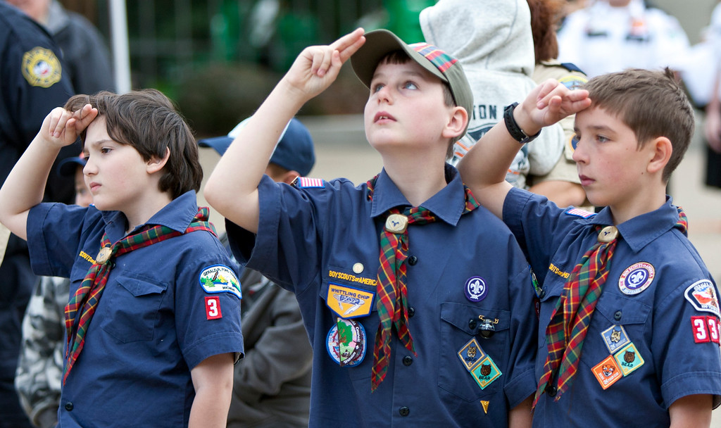 . Cub Scouts, from left, William Wright, 9, David Simon, 10, Jack Munn, 10, salute during a ceremony marking the anniversary of the Sept. 11, 2001, terrorist attacks, at the Gerald R. Ford Presidential Museum in Grand Rapids, Mich., Thursday, Sept. 11, 2014. The three are from Kent City Cub Scout Pack 3322. (AP Photo/The Grand Rapids Press, Cory Morse)