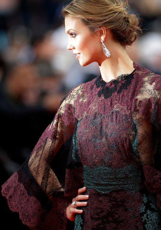 . Model Karlie Kloss arrives for the opening ceremony and the screening of Grace of Monaco at the 67th international film festival, Cannes, southern France, Wednesday, May 14, 2014. (AP Photo/Thibault Camus)