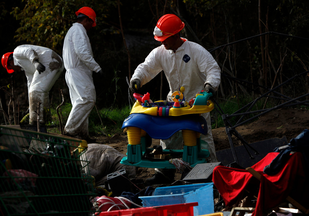 . Clean-up crews begin clearing The Jungle homeless camp along Story Road  in San Jose, Calif., after the city closed it Thursday, Dec. 4, 2014. (Karl Mondon/Bay Area News Group)