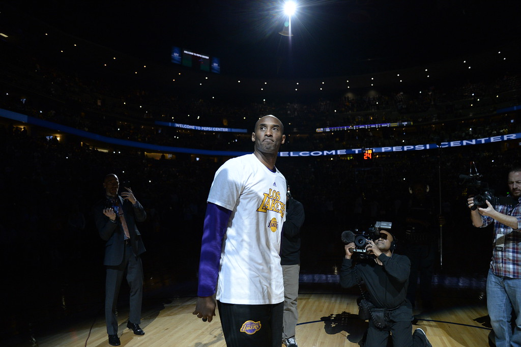 . DENVER, CO - MARCH 2: Kobe Bryant of the Los Angeles Lakers acknowledges the crowd during introductions before his last NBA game in Denver. The Denver Nuggets hosted the Los Angeles Lakers at the Pepsi Center in Denver, Colorado on March 2, 2016.  (Photo by John Leyba/The Denver Post)