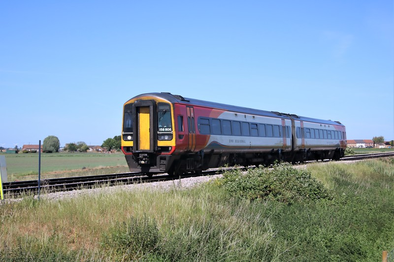 158806 passing Wisbech Road crossing, Manea at 1106/1L05 Liverpool to Norwich