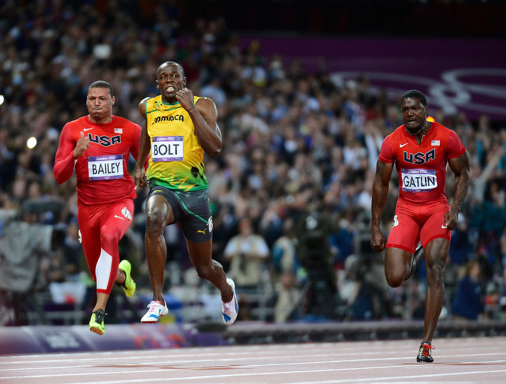 . Jamaica Usain Bolt is flanked by USA Ryan Bailey and Justin Gatlin during the men\'s 100m final. Bolt set an Olympic Record of 9.63 seconds in the 100m, the second quickest in history Sunday, August 5, 2012 at the London 2012 Summer Games. John Leyba, The Denver Post
