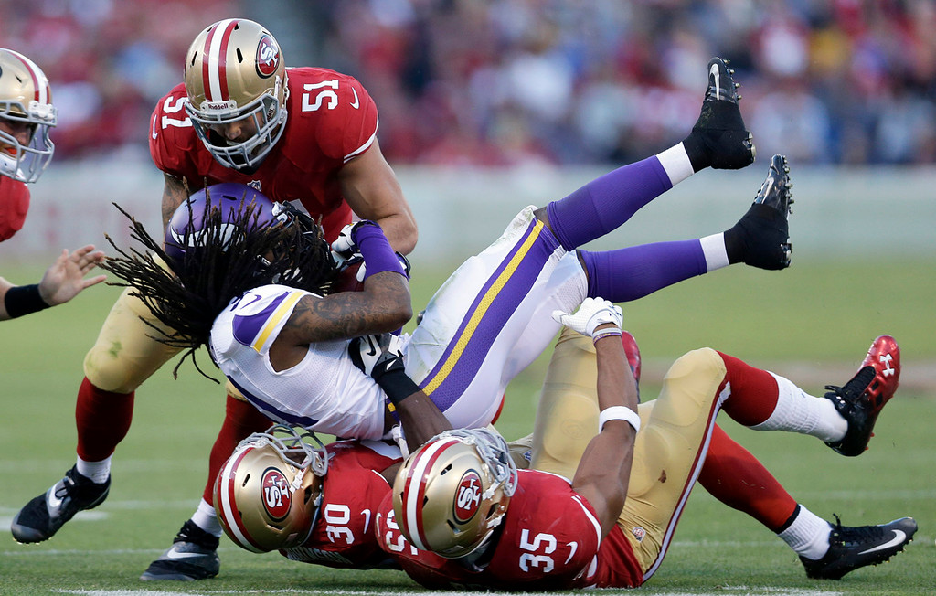 . Minnesota\'s Bobby Felder is tackled by 49ers linebacker Dan Skuta (51), free safety Trenton Robinson (30) and safety Eric Reid (35) during the third quarter. (AP Photo/Marcio Jose Sanchez)
