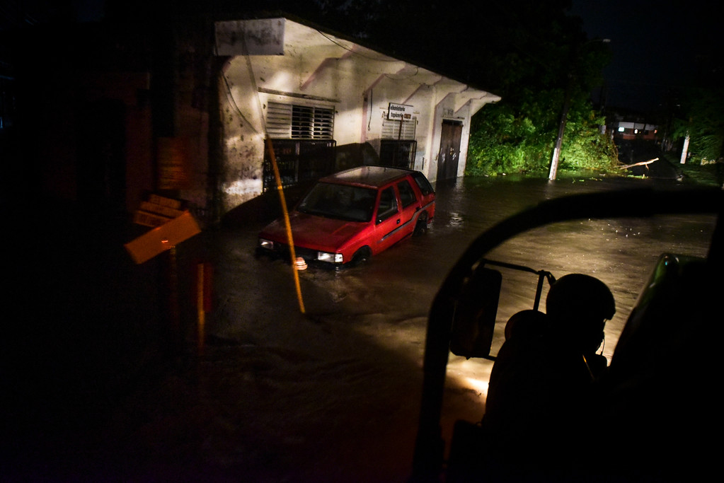 . Rescue staff from the Municipal Emergency Management Agency investigate an empty flooded area during the passage of Hurricane Irma through the northeastern part of the island in Fajardo, Puerto Rico, Wednesday, Sept. 6, 2017. Hurricane Irma lashed Puerto Rico with heavy rain and powerful winds, leaving nearly 900,000 people without power as authorities struggled to get aid to small Caribbean islands already devastated by the historic storm. (AP Photo/Carlos Giusti)