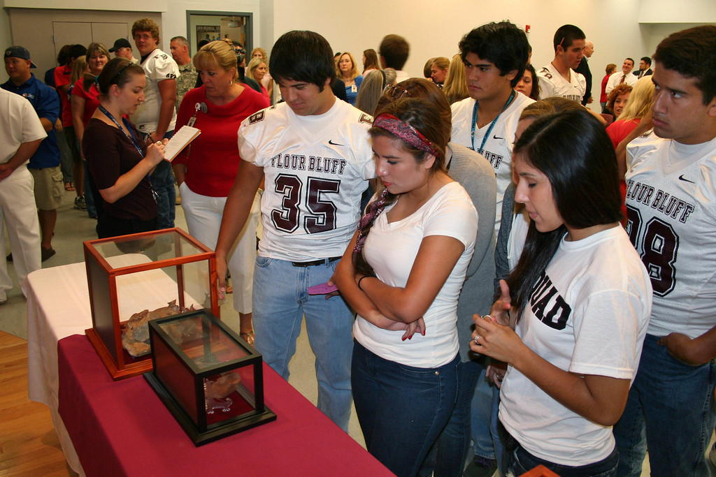 . In this September 2011 photo provided by the Flour Bluff Independent School District, students look at a piece of steel from the World Trade Center building which was destroyed 10 years earlier, during a 9/11 commemoration event at the Flour Bluff junior high and high school campus in Corpus Christi, Texas. The artifact is �twisted and somewhat burned. It�s not pretty. I�m hoping it will make them think as they�re growing up, that they have to pay attention to their past,� says Bruce Chaney, the naval science instructor who applied for the artifacts. (Hector Zapata/Flour Bluff Independent School District via AP)