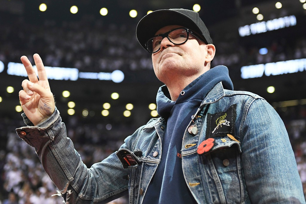 . Lead singer of The Tragically Hip Gord Downie salutes fans during the first half of Game 3 of an NBA basketball second-round playoff series between the Toronto Raptors and the Cleveland Cavaliers in Toronto on Friday, May 5, 2017. (Frank Gunn/The Canadian Press via AP)