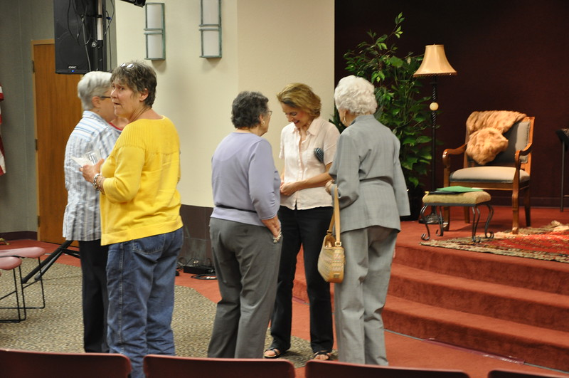 Dolores Hydock visits with fans after the play.jpg