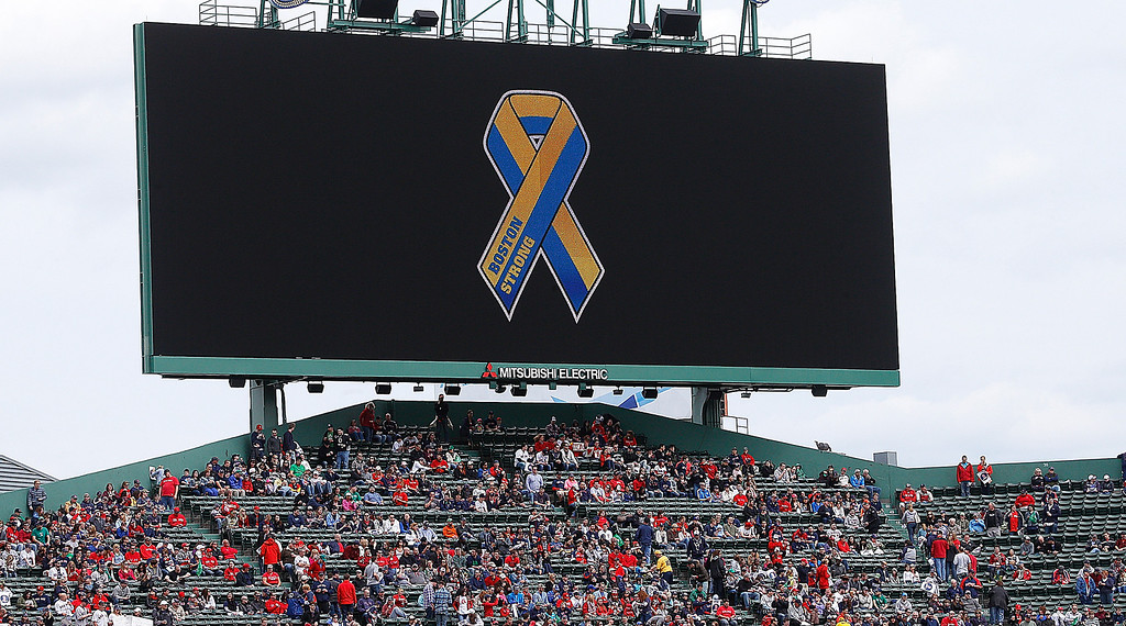 . BOSTON, MA - APRIL 20:  A ribbon is displayed as a symbol of the Marathon bombing victims before a game between the Boston Red Sox and the Kansas City Royals at Fenway Park on April 20, 2013 in Boston, Massachusetts.  (Photo by Jim Rogash/Getty Images)