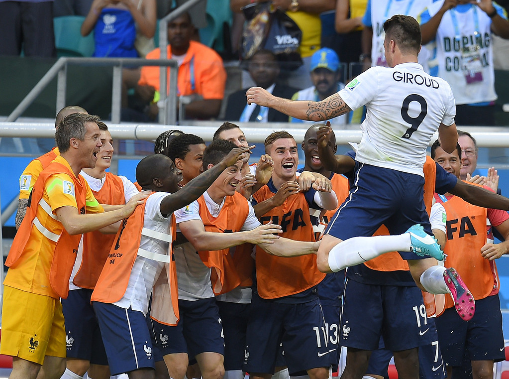 . France\'s forward Olivier Giroud (top R) celebrates scoring his team\'s first goal during a Group E football match between Switzerland and France at the Fonte Nova Arena in Salvador during the 2014 FIFA World Cup on June 20, 2014.  FABRICE COFFRINI/AFP/Getty Images