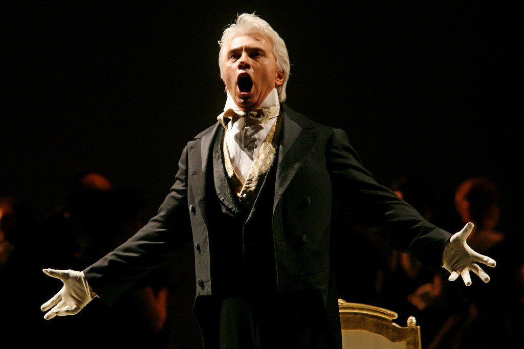 """. FILE - In this Feb. 6, 2007, file photo, Dmitri Hvorostovsky performs during the final dress rehearsal for the opera \""""Eugene Onegin\"""" in New York. The beloved Russian baritone �died peacefully� early Wednesday morning, Nov. 22, 2017, after a long battle with cancer near his home in London, his office said in a statement. He was 55. (AP Photo/Shiho Fukada, File)"""
