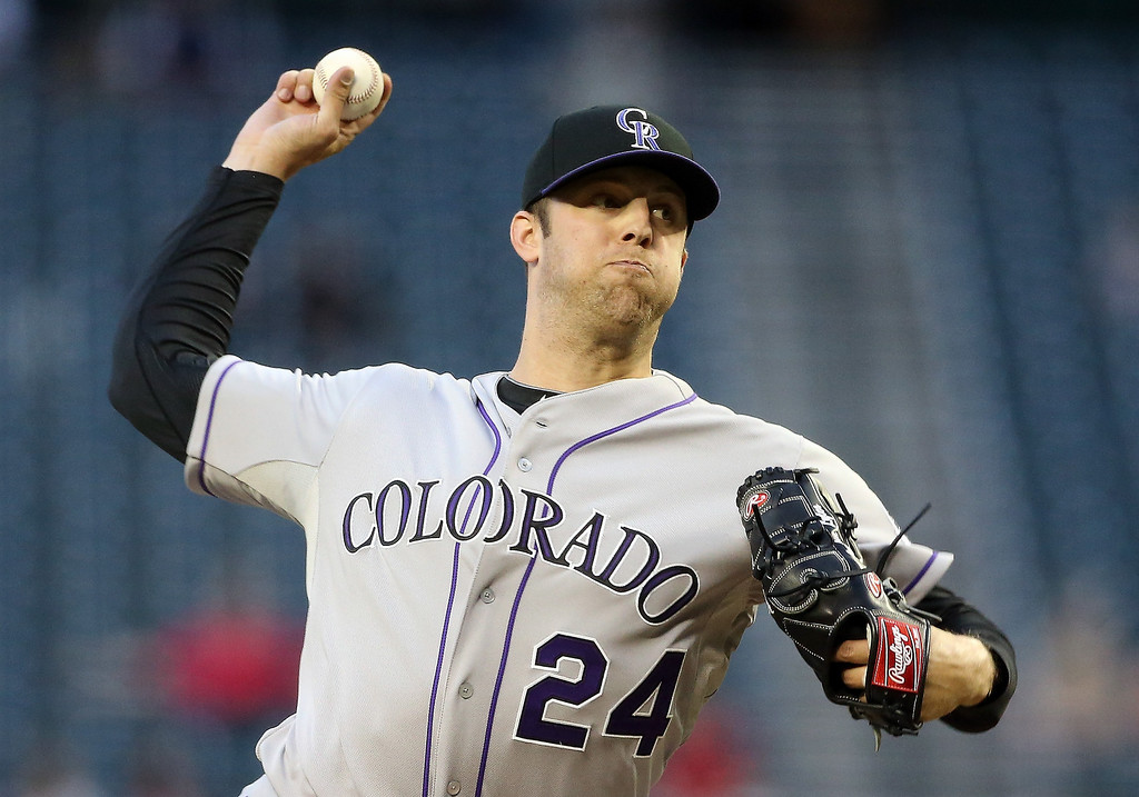 . Starting pitcher Jordan Lyles #24 of the Colorado Rockies pitches against the Arizona Diamondbacks during the MLB game at Chase Field on April 30, 2014 in Phoenix, Arizona.  (Photo by Christian Petersen/Getty Images)