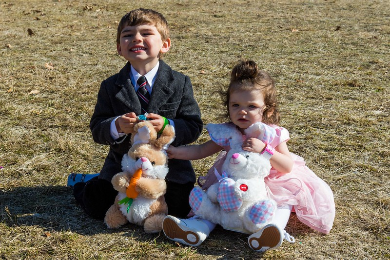 Bryar Moody, 3, and Temperance Brooks, 1, enjoy some candy during the Next Level Church's Helicopter Egg Drop and Family Event at the Rochester Fairgrounds Sunday. [Scott Patterson/Fosters.com]