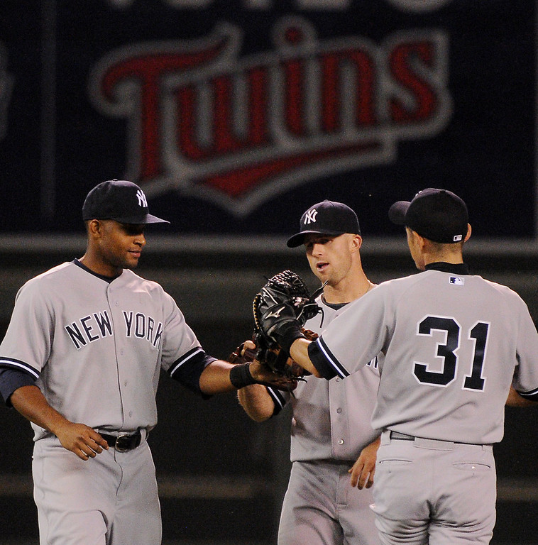 . New York\'s Zoilo Almonte, left, Brett Gardner and Ichiro Suzuki (31) celebrate their 7-3 victory over the Twins.  (Pioneer Press: John Autey)