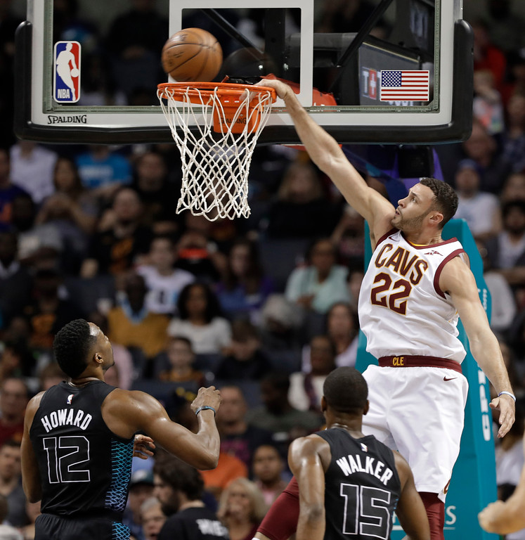 . Cleveland Cavaliers\' Larry Nance Jr. (22) misses a dunks as Charlotte Hornets\' Dwight Howard (12) and Kemba Walker (15) watch during the first half of an NBA basketball game in Charlotte, N.C., Wednesday, March 28, 2018. (AP Photo/Chuck Burton)