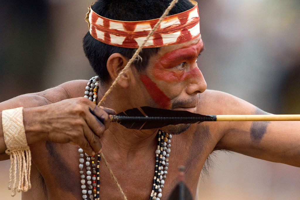 . A Brazilian indigenous man of the Maiorona tribe takes part in the bow and arrow competition during the XII International Games of Indigenous Peoples in Cuiaba, Mato Grosso state, Brazil on November 12, 2013. AFP PHOTO / Christophe SIMON/AFP/Getty Images