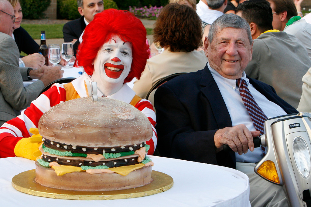 . In this Aug. 21, 2008 file photo Big Mac creator Jim Delligatti, right, poses with a Big Mac birthday cake and Ronald McDonald at his 90th birthday party in Canonsburg, Pa.. (AP Photo/Gene J. Puskar/File)