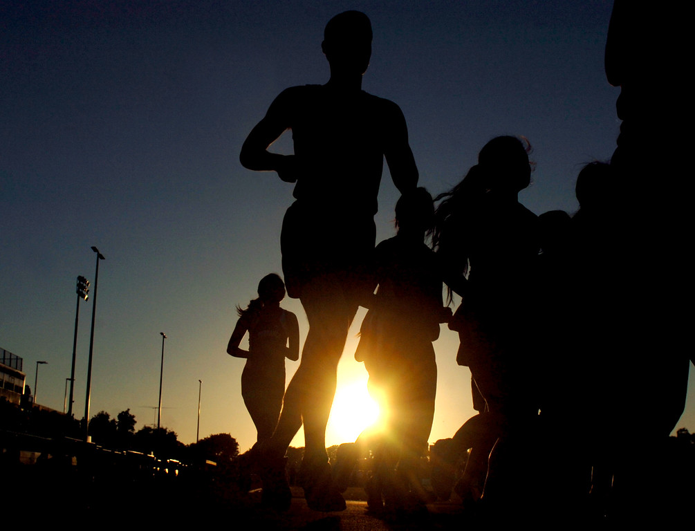 . The Torrance High School TrackTeam Distance Runners take two laps during the Louis Zamperini Celebration of Life in Torrance CA. Thursday July 31, 2014. (Thomas R. Cordova-Daily Breeze/Press-Telegram)