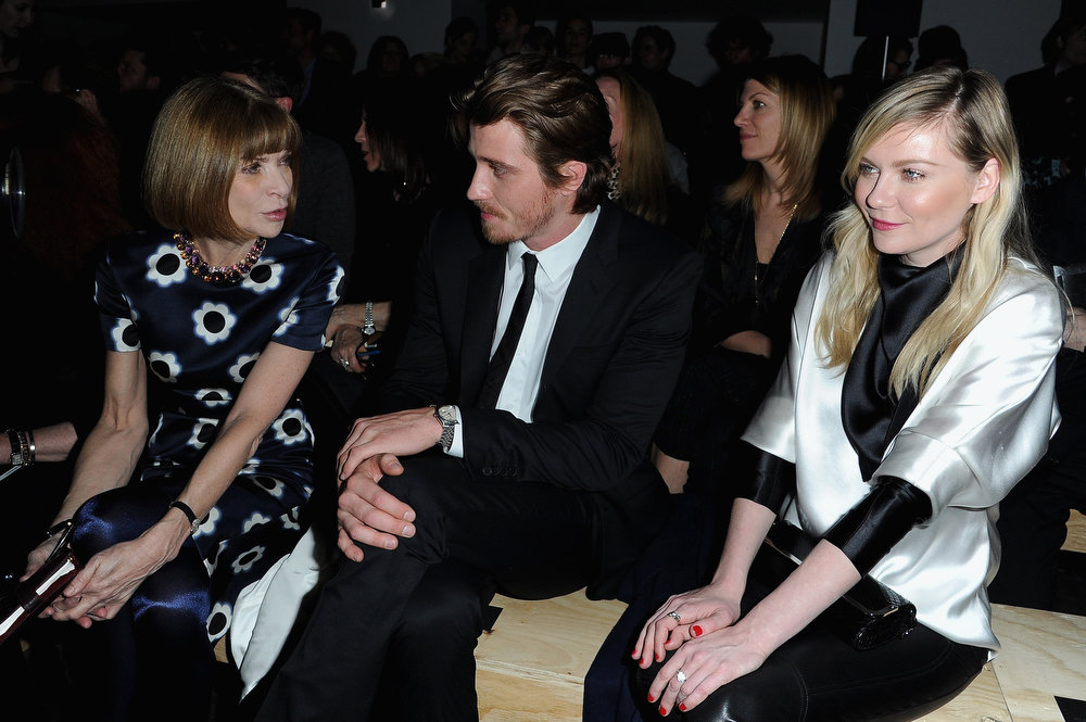 Description of . Anna Wintour, Kirsten Dunst and Garrett Hedlund attend the Saint Laurent Fall/Winter 2013 Ready-to-Wear show as part of Paris Fashion Week on March 4, 2013 in Paris, France.  (Photo by Pascal Le Segretain/Getty Images)