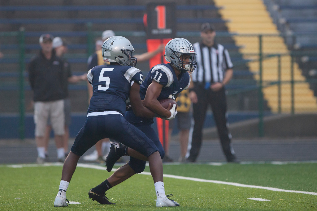 . Jen Forbus - The Morning Journal<br> Lorain quarterback Jordan Jackson hands off to running back Daylin Dower against St. Joseph on Sept. 14.
