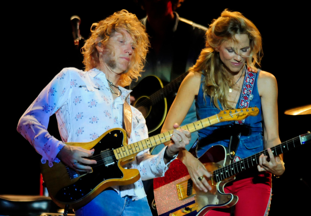 """. Peter Stroud, left, and Sheryl Crow  perform the song \""""Steve McQueen\""""  at the Minnesota State Fair Grandstand Sunday night, August 25, 2013.  (Pioneer Press: Scott Takushi)"""