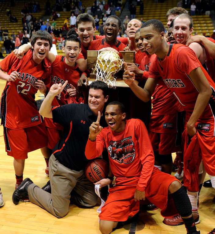 . BOULDER, CO. - MARCH 16: The Raptors posed with the trophy Saturday night after the win over the Angels. The Eaglecrest High School boy\'s basketball beat Denver East 63-44 in the 5A championship game Saturday, March 16, 2013 at the Coors Events Center in Boulder.  (Photo By Karl Gehring/The Denver Post)