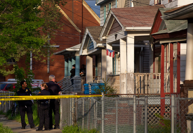 . Cleveland Police stand outside a home where they say missing women, Amanda Berry, Gina DeJesus and Michele Knight were found in the 2200 block of Seymour Avenue in Cleveland on Monday, May 6, 2013. The three women who went missing about a decade ago were found alive in a residential area just south of downtown, and a man was arrested. (AP Photo/Plain Dealer, Scott Shaw)