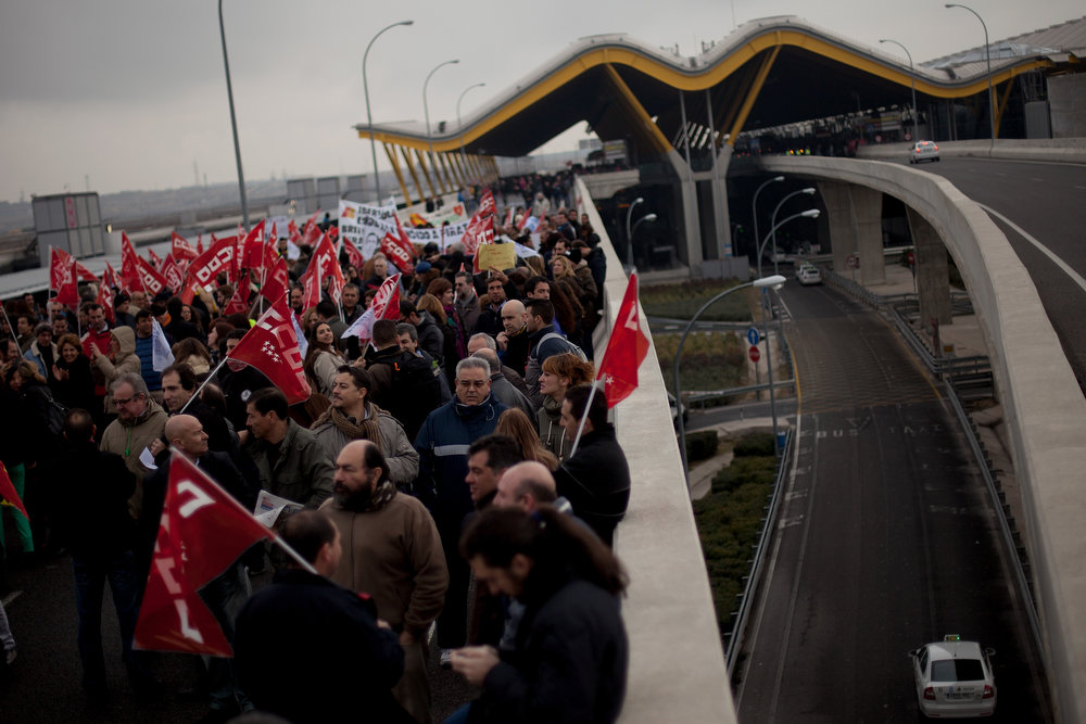 . Spanish Airline Iberia staff walk near the highway as they protest against job cuts outside Barajas Airport on February 18, 2013 in Madrid, Spain. Today is the first of a five day strike held by Iberia cabin crew, maintenance workers and ground staff in response to the planned loss of 3,800 jobs. The strike has resulted in the airline having to cancel 400 flights this week with unions planning a further five day strikes within a month.  (Photo by Pablo Blazquez Dominguez/Getty Images)